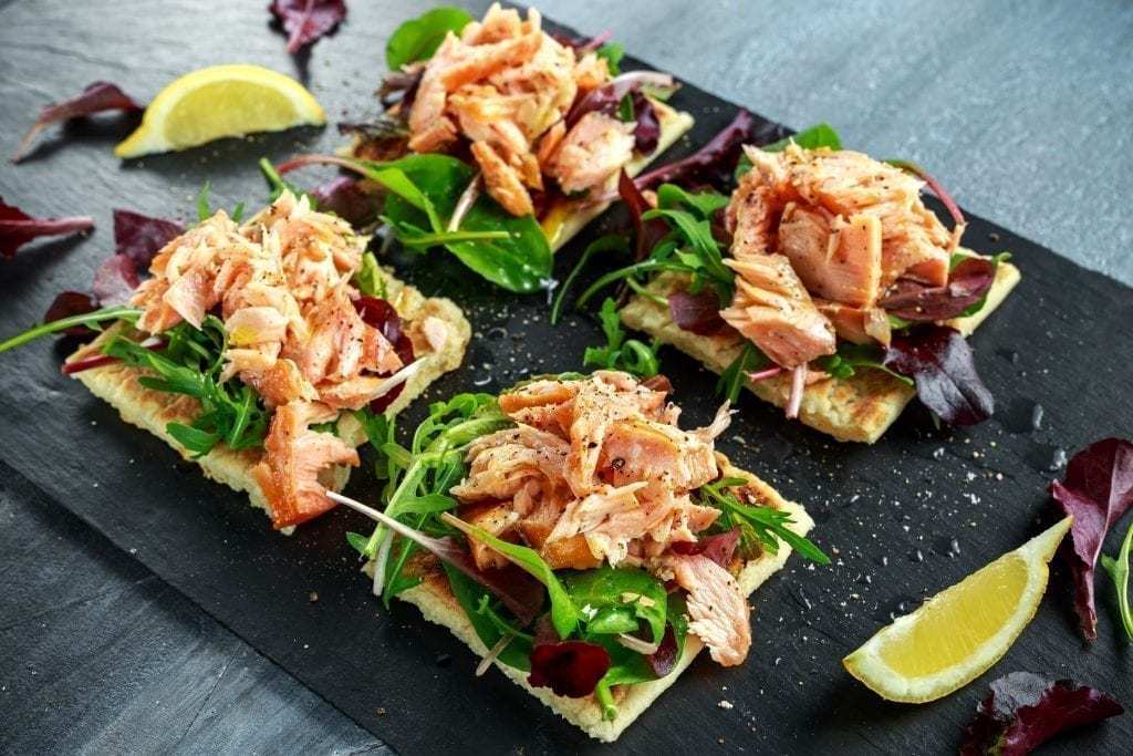 snacks and appetizers: Smoked salmon flakes on salad bed and irish potato slims